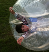 A boy rolled onto his side in a BodyZorb