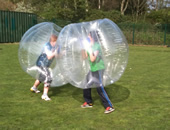 Two boys bumping each other with the BodyZorbs