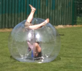 A youngster rolling over in a BodyZorb